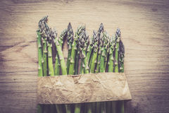 Asparagus bunch close up on wooden background Stock Photography