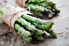 Asparagus. Bunch of fresh asparagus on wooden table royalty free stock photos