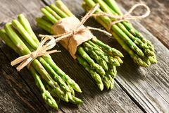 Asparagus. Bunch of asparagus over rustic wooden background royalty free stock image