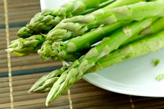 Asparagus. Bunch of asparagus on plate stock photo