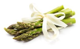 Asparagus. Bunch of raw asparagus tied with a creamy knot isolated on white backgroundn Royalty Free Stock Photos