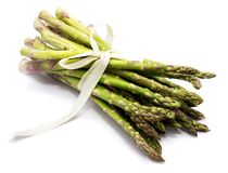 Asparagus. Bunch of raw asparagus tied with a creamy knotbow isolated on white backgroundn Stock Images