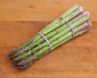 Asparagus Bunch on Wood Chopping Board Royalty Free Stock Photography