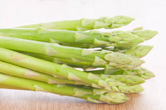 Asparagus bundle on wooden background Stock Photography