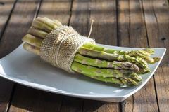 Asparagus bundle on a wooden  background Royalty Free Stock Photo
