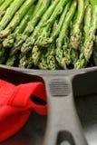 Asparagus in cast iron skillet. Asparagus spears in cast iron skillet cooking on stovetop Stock Image
