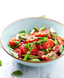 Asparagus and Cherry Tomato Salad with Pine Nuts and fresh Herbs Stock Photos