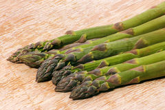 Asparagus on chopping board Stock Image