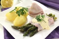 Asparagus with cooked ham Stock Photos