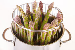 Asparagus in cooker. Stainless steel asparagus cooker closeup Stock Photos