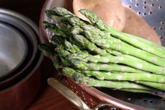 Asparagus in Copper Colander. Ths is an image of asparagus and potatoes in a copper colander royalty free stock images