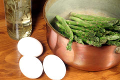 Asparagus in Copper Pot with Eggs and Vinegar Bottle Royalty Free Stock Photography