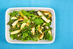 Asparagus, courgette and hazelnut salad in a rectangular dish Stock Photo