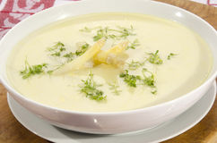 Asparagus cream soup in a white bowl Royalty Free Stock Photography