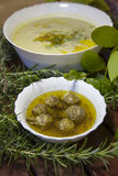 Asparagus creamy soup and artichoke hearths Royalty Free Stock Photos