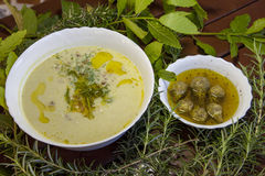 Asparagus creamy soup and artichoke hearths Stock Images