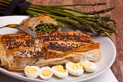 Asparagus In Crust With Poppy Seeds And Quail Eggs Stock Photography