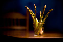 Asparagus in a cup. Asperagus in a cup on a table spread out in a fan pattern Stock Photo