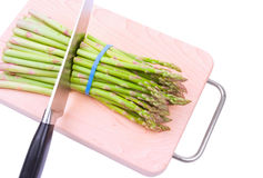 Asparagus cut with a knife. Isolated Stock Image