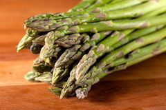 Asparagus on cutting board Royalty Free Stock Images