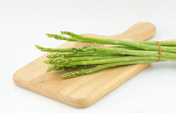 Asparagus and Cutting board isolated on white Stock Photography