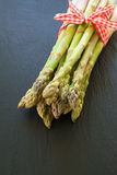 Asparagus with fabric ribbon Royalty Free Stock Photos