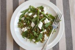 Asparagus and feta salad. Roast asparagus, pea and feta salad on a plate Stock Photo