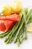 Asparagus with fish and potato Royalty Free Stock Photos