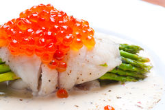 Asparagus with fish and red caviar in creamy sauce Royalty Free Stock Photo
