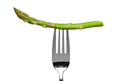 Asparagus on a fork isolated on white Stock Image