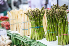 Asparagus. Fresh bundles of white and green asparagus on market place.  Stock Image