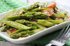 Asparagus fried with bacon Royalty Free Stock Photos