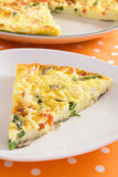 Asparagus Frittata. Beautiful frittata filled with asparagus, red bell pepper, mushrooms, ricotta, and parmesan cheese royalty free stock images