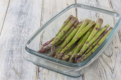 Asparagus in glass dish Royalty Free Stock Photos