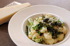 Asparagus and Gnocchi. Asparagus with gnocchi in creamy sauce garnished with parmesan cheese and chopped parsley stock image