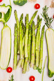 Asparagus and green vegetables on white wooden background, top view Stock Photos