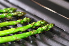Asparagus on a grill Stock Images