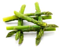 Asparagus. Group of boiled steam asparagus crossed in well isolated on white backgroundn Stock Image