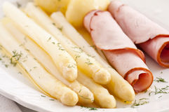 Asparagus with ham and butter Royalty Free Stock Image
