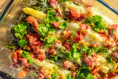 Asparagus with ham and cheese Stock Images