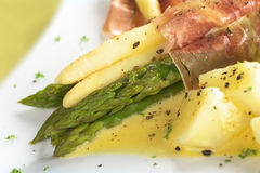 Asparagus with Ham and Hollandaise Sauce Royalty Free Stock Photo