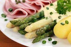 Asparagus with ham and hollandaise sauce Stock Photo