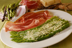 Asparagus with ham and parmesan. On a plate Stock Images