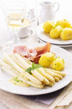Asparagus with Ham and Potato on Plate Royalty Free Stock Images