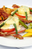 Asparagus ham tomato eggs benedict Royalty Free Stock Photos