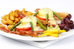 Asparagus ham tomato eggs benedict Royalty Free Stock Images
