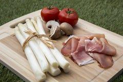 Asparagus with ham. On wood Stock Photos