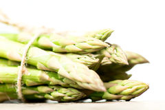Asparagus heads on wooden table macro side view Royalty Free Stock Image