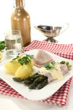 Asparagus with hollandaise sauce and parsley Stock Image
