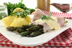 Asparagus with hollandaise sauce and potatoes Royalty Free Stock Photo